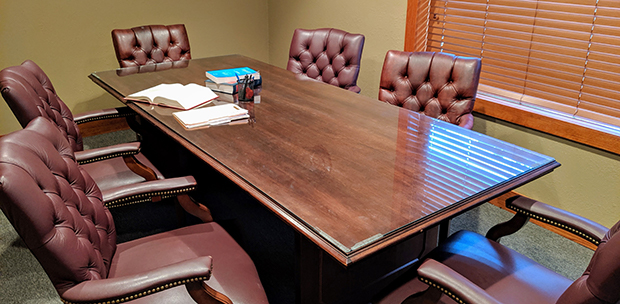 Vondra Malott conference room with legal books